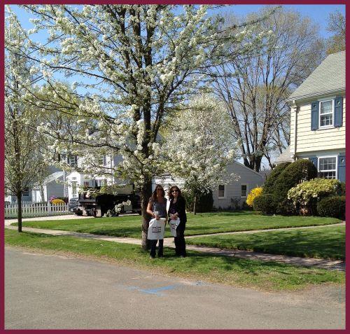 Realtors Lisa Holden and Beth Cantor collecting bags in Hamden neighborhoods.