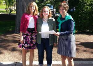 Calcagni Real Estate agents Gina Shumilla (left) and Sandy Wagner (right) present Cheshire High School senior Kelsey Uguccioni (center) with Calcagni's annual $500 college scholarship.